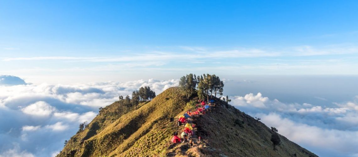 Camping site on crater rim of Mount Rinjani at sunset. Lombok Island, Indonesia.